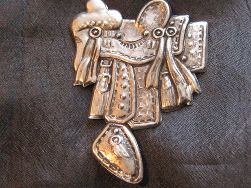 saddle brooch